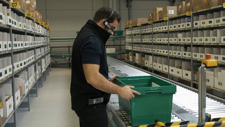 Video thumbnail of Man in warehouse on pick/scan assembly line